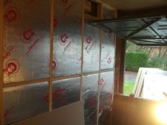 Insulation in place in wooden framework
