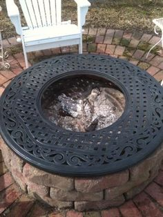 Here's the firepit I made, along with the round brick patio I created in our backyard.  I found this grate at a junk shop, and added it to be decorative.  In the summer I'd like to add a round piece to fit in the hole to serve as a coffee table/cocktail table : )  I think I will use crete board and do a mosaic decoration on it.