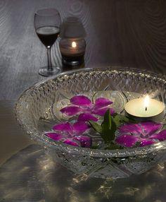 floating purple flowers and votive centerpiece