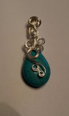 Wire wrapped howlite turquoise pendant.