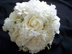 Gardenias Roses and Stephanotis Wedding Flowers  This gorgeous bridal bouquet takes time to make because of its wonderful detail of rhinestones, pearls and hydrangea organza appliqued ribbon. It is adorned with roses, gardenias and stephanotis along with beautiful white hydrangeas.