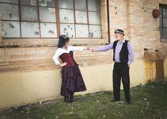 Happy dancing steam punk couple