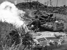 "An American tank destroyer ""Hellcat"" firing on fortified positions in Shuri, Okinawa; April - In the Pacific Theater, the was often used in a fire support role instead of as a tank destroyer."