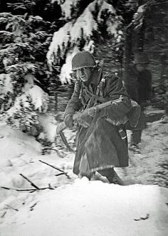 American troops take part in an attack on a German machinegun position during the Battle of the Bulge in the Ardennes Belgium December 1944