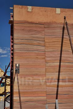 A load-bearing SIREWALL recently stripped of its forms. South East Wyoming Welcome Centre. To learn what makes SIREWALL the most advanced rammed earth technology in the world visit our website.