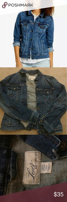 Levi's Trucker Jacket XS Levi San Francisco Women's trucker jacket. Worn and washed several times. A medium dark blue wash. Fits like a true extra small, with 4 exterior pockets. Smoke free and pet free home. Levi's Jackets & Coats Jean Jackets