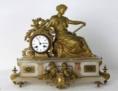 A French 19th century marble and gilt metal mantle clock, the enamelled dial with eight day movement with an artesian figure beside a stepped marble base.