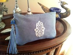 Hey, I found this really awesome Etsy listing at http://www.etsy.com/listing/122861281/blue-and-silver-moroccan-clutch