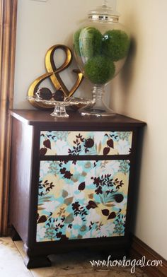 Who says you can't mod podge paper to furniture?