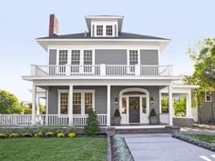 They kept all the home's original windows but ripped off and rebuilt the porches, and painted the siding greenish gray (Messenger Bag) and the front door dark gray (Iron Ore, both by Sherwin-Williams). They painted the trim Dover White by HGTV HOME by Sherwin-Williams.