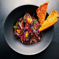 Mussels in beer sauce and beetroot sprouts.