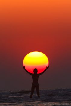 One of the coolest sunset pictures I've seen! I'd like to take one of these someday