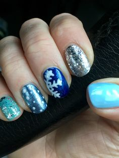 Blue and silver Christmassy winter snowflake nails
