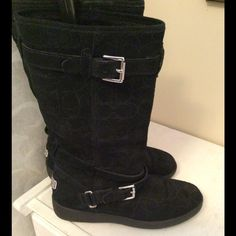COACH Boots EUC Size 8.5 Black suede, fur lined authentic COACH boots. Excellent used condition. Signature C insignia is on the outside of boot (see picture). Having a hard time parting with these boots...but I have too many and had to purge. You won't be disappointed with this purchase Coach Shoes Winter & Rain Boots