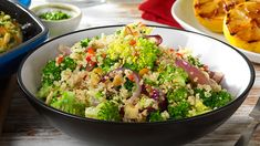 QUINOA SALAD - This light and fresh tasting quinoa salad is made with broccoli florets, vegetable stock, chillies and almonds. It's so easy and quick. To serve, the quinoa is drizzled in a sweet and tangy dressing. Surprise the family with this gem of a recipe.