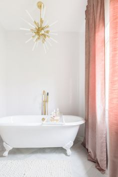 Bathroom design with white stand alone tub, gold accents and beautiful blush draped curtains | AlyssaRosenheck2016 For Domino Magazine with Elsie Larson
