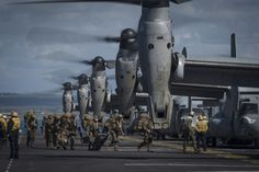 Marines from the 11th Marine Expeditionary Unit (11th MEU) board MV-22 Ospreys attached to Marine Medium Tiltrotor Squadron 163 (Reinforced) as they prepare to launch from the flight deck of the amphibious assault ship USS Makin Island (LHD-8) on Feb. 23, 2015. US Navy Photo