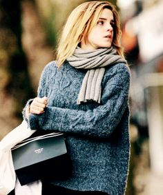 Dark blueish thick sweater with gray scarf.