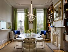Eclectic Dining Room by Francis Dzikowski Photography Inc.