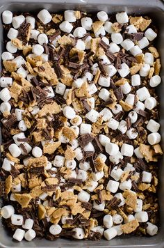S'mores rice crispy treats take your classic rice krispie square and add chocolate and graham crackers for the ultimate easy dessert.