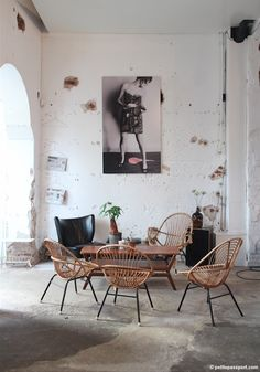 Rustic setting with mcm furnishings--via Petite Passport