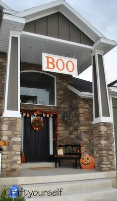"""Love a nice front porch - great for holiday decor (as evidenced by """"BOO"""" sign)"""