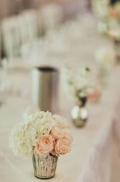 Top table flowers various mercury silver vessels with blush pink and white blooms by @kmorganflowers
