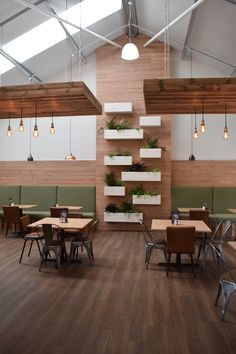 Plant feature wall and copper light fittings in the seating area of the Hillier Garden Center.
