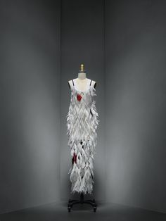 Proenza Schouler (American, founded 2002), Lazaro Hernandez (American, born 1978), Jack McCollough (American, born Tokyo, 1978). Dress, spring/summer 2016, Prêt–à–Porter. Machine–knit white viscose; overlay: hand–cut white and red dyed pheasant feathers, hand–linked with silver metal hardware. Photo © Nicholas Alan Cope. #ManusxMachina #CostumeInstitute