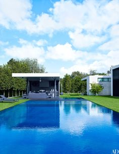 At baseball star Alex Rodriguez's home in Coral Gables, the area around the wet-edge pool was fitted with artificial grass to conserve water.