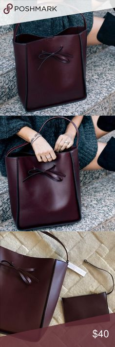 "Sole Society Primm Tote bag in burgundy A minimalist tote adorned with a sweet bow detail. Designed in vegan leather with a structured bucket shape. Material: Vegan Leather Dimensions: 13""H x 10""W x 5""D Handle Drop: 9"" Sole Society Bags Totes"