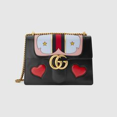 0622d2daf3c59 Shop the GG Marmont leather shoulder bag by Gucci. A GG Marmont shoulder  bag with Western details on the front flap and a mouth leather detail on  the back.