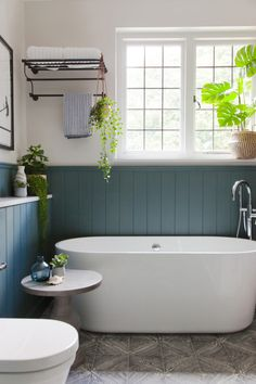 Home Renovation Modern teal-painted bathroom with a white standing tub - Struggling to vamp up your traditional family home? Tour this bold yet functional home designed by Studio. Bathroom Storage Solutions, Rustic Bathroom Designs, Modern Bathroom Design, Home Remodeling, Bathroom Renovations, Bathroom Flooring, Bathroom Floor Storage, Bathrooms Remodel, Bathroom Design