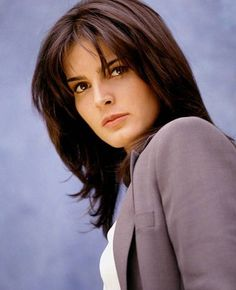 Angie Harmon-She's young here. Looks like during her Law and Order-SVU days.
