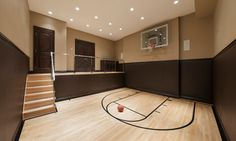Home basketball court. Very cool and if you don't like the basketball concept then you could easily replace it with a dance studio/workout room/TV area/etc.