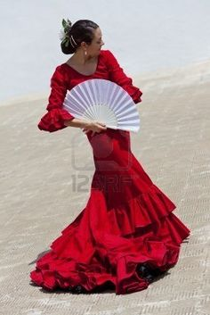 Google Image Result for http://us.123rf.com/400wm/400/400/dmbaker/dmbaker1006/dmbaker100600049/7167777-woman-traditional-spanish-flamenco-dancer-dancing-in-a-red-dress-with-a-white-fan.jpg