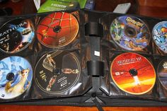 Get rid of all that DVD packaging and put them into books!  Have one for the kids' movies, adult movies and one for chick flicks...