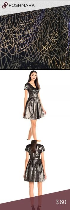 NWT Vince Camuto black & gold dress. New Years Eve Retail $159! Perfect for NYE. New never worn. Glitter, Gold, Black NYE! Vince Camuto Dresses Mini