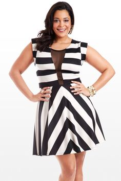 This A-line beauty features a bold print of black and white stripes and daring mesh cutouts that amp up the sex-appeal. Seamed at the waist, with cute cap sleeves, and a flouncy A-line skirt, this is style so fierce you might just get arrested.
