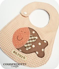 https://flic.kr/p/7PyJqy | set bimba | bib and fish gift set for a baby girl design bib: sogdt og blodt book fish: Melly and me handmade by me