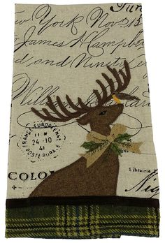 Features:  -Reindeer collection.  -Embroidered reindeer on print fabric.  -Ribbon and green tartan accents.  -Available in pillows, stockings, mats and guest towels.  Product Type: -Decorative Accents
