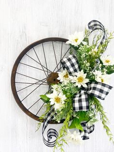 We're taking our inspiration with this rusted wheel and creating a farmhouse bike wheel wreath. Customize the design for any season!