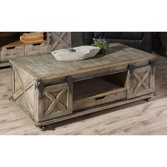 This Rustic Gray Wood Rolling Barn Door Coffee Table's distressed finishes and industrial style will give your living room an instant vintage makeover. Door Coffee Tables, Pine Coffee Table, Coffee Table Size, Stylish Coffee Table, Reclaimed Wood Coffee Table, Rustic Coffee Tables, Decorating Coffee Tables, Coffee Table Design, Nautical Coffee Table