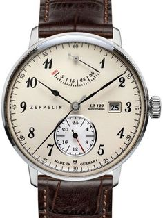 Graf Zeppelin 7060-4 Watch comes with a power reserve meter at 12:00 and a white 24 hour sub-dial at 6:00. Features a domed Hesalite crystal and a modified 26-jewel Citizen self-winding movement with a silver rotor.