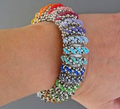 Rainbow Bracelet Instructions by Ravit on Etsy leather w/magnetic clasp, seed & peanut beads