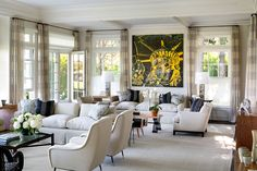 In this East Hampton, New York, living room, completed by DKDA in 2014, the neutral palette puts the focus on the Andy Warhol painting above the sofa. The room includes a pair of travertine and polished steel lamps from Karl Kemp Antiques and Italian 1970s armchairs from Gustavo Olivieri. Photo by Peter Aaron