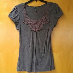 Maurices Gray Embroidered Bib Neckline Tee Maurices brand, size small, in excellent used condition! The fabric is super duper soft! The sleeves are slightly puffy and the embroidered neckline is a gorgeous, delicate detail! Color is a charcoal gray. Please ask any and all questions before purchasing. No trades. Make a reasonable offer. Thanks! Maurices Tops Blouses