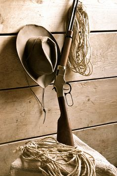 Lever action rifle, cowboy hat, rope.