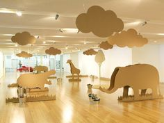 Giant cardboard animals, clouds, trees etc.