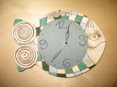 keramické hodiny, ryba